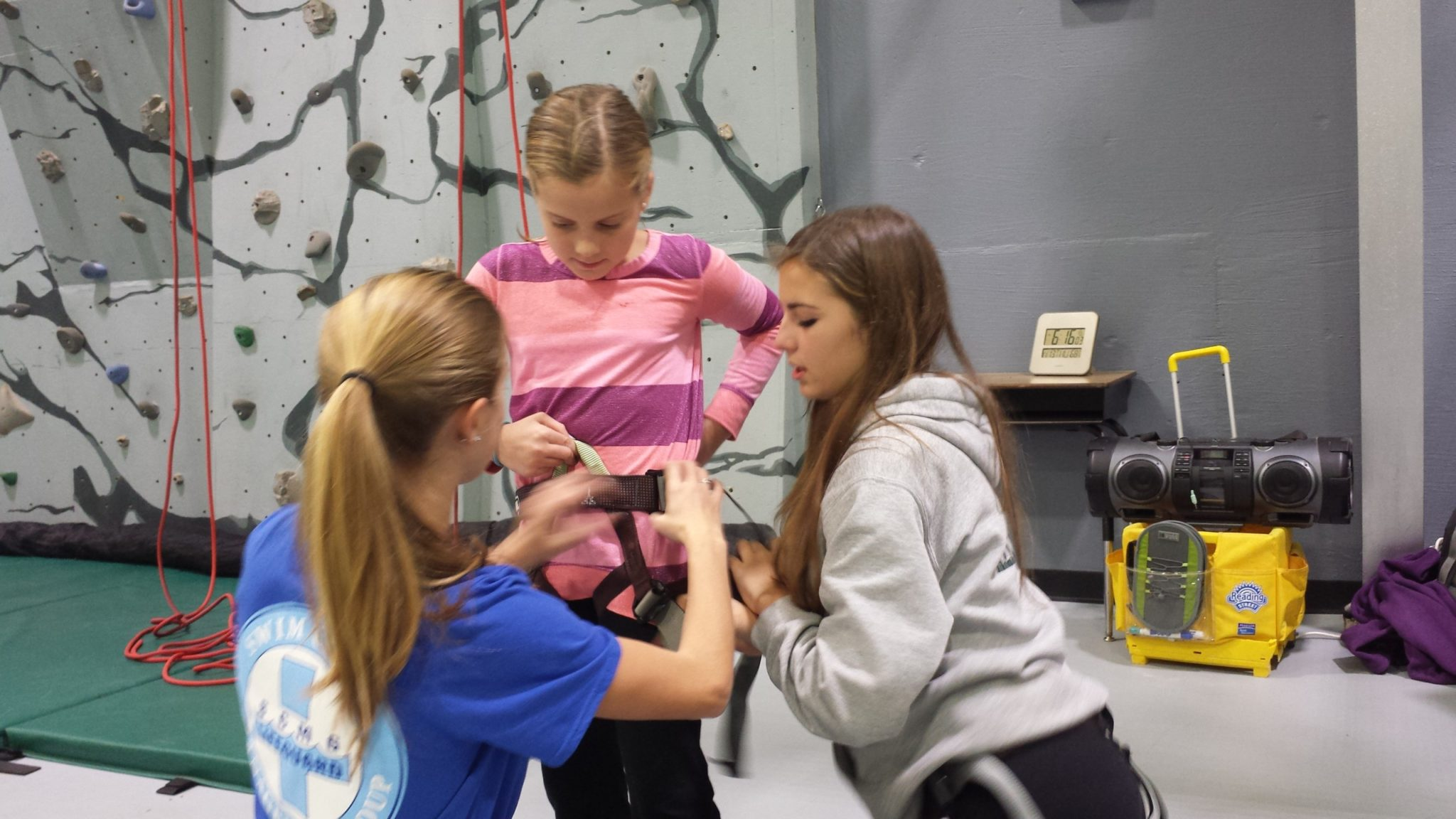 TAASC students teaching younger climbers